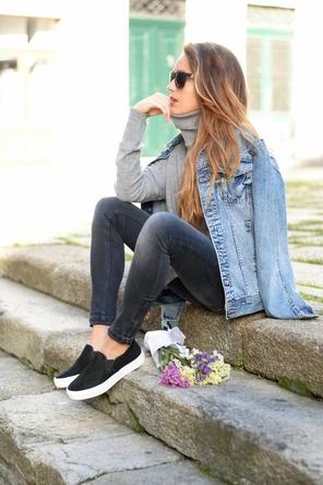 denim jacket / grey sweater / faded grey or black denim / slip-on sneakers