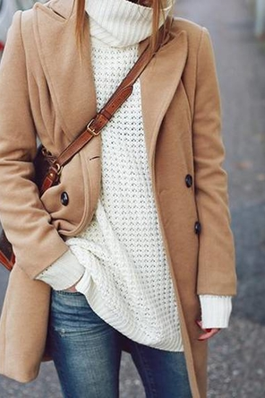 distressed denim / camel coat / beige oversized sweater