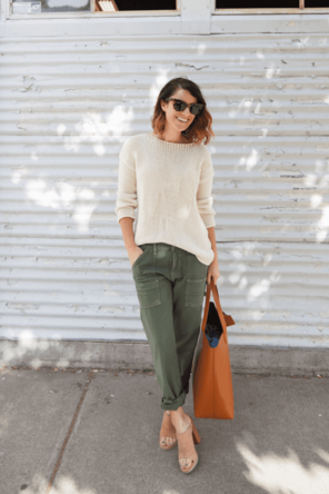 beige knit sweater / olive cargos / neutral heels / cognac bag