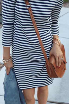 striped dress / denim jacket / cognac bag