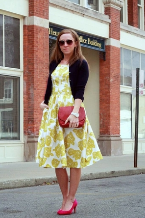 yellow floral dress / black cardigan / red accessories + heels