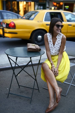 yellow skirt / patterned sleeveless top / tan accents