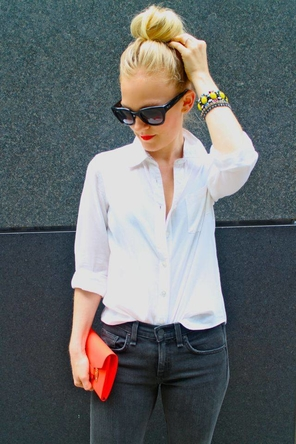 white button-down / dark grey denim / bright clutch